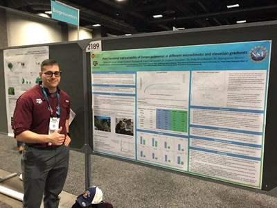 AGU poster with Manny.JPG